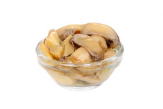 Pickled mushrooms in glass bowl Royalty Free Stock Photos