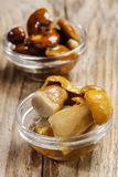 Pickled mushrooms in transparent glass bowl Stock Photo