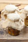 Pickled mushrooms in transparent glass jar Stock Images
