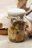 Pickled mushrooms in transparent glass jar Royalty Free Stock Photo