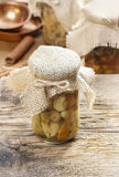 Pickled mushrooms in transparent glass jar Royalty Free Stock Images
