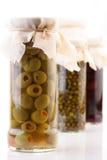 Pickled olives in jar - studio shot Stock Images