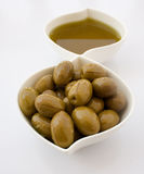pickled olives and olive oil Stock Photography