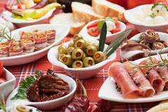 Pickled olives with other antipasto food Stock Photo