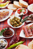 Pickled olives with other antipasto food Stock Photos