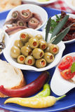 Pickled olives with other antipasto food Stock Image