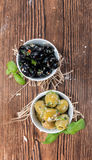 Pickled Olives. Some pickled Olives (close-up shot) with garlic an fresh herbs stock image