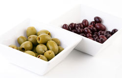 Pickled olives in white bowl Stock Photos
