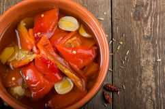 Pickled peppers in a bowl. Rustic Stock Photos