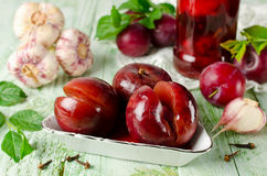 Pickled plum with garlic Stock Photo