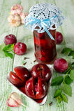 Pickled plum with garlic Stock Photos