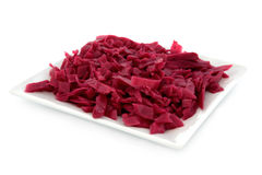 Pickled Red Cabbage. On a square porcelain plate over white background Royalty Free Stock Images