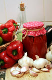 Pickled red pepper. Red pepper paprika stores for the winter in the glass jar Stock Photos
