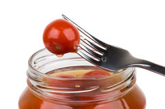 Pickled red tomatoes on fork royalty free stock images
