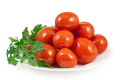 Pickled red tomatoes with green parsley Royalty Free Stock Photo