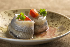Pickled rollmops herrings Stock Photo