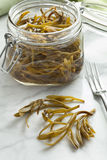 Pickled samphire. In a glass jar Stock Image