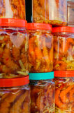 Pickled shrimp in glass cans Stock Photos