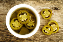 Pickled sliced green jalapeno peppers Stock Photography
