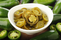 Pickled sliced green jalapeno peppers Stock Photo