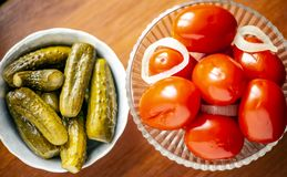 Pickled tomatoes and pickled cucumbers royalty free stock photography