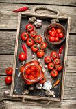Pickled tomatoes with garlic and spices stock photography