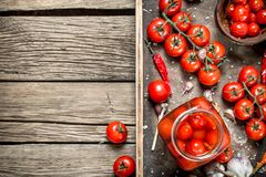 Pickled tomatoes with garlic and spices stock image