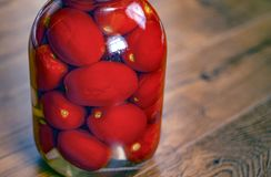 Pickled tomatoes.pickled tomatoes in a jar royalty free stock photo
