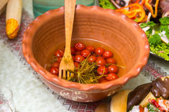 Pickled tomatoes on a plate. Beautiful and tasty food on a plate Royalty Free Stock Photography