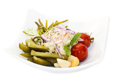 Pickled vegetables. Cucumber tomatoes asparagus and garlic cabbage Royalty Free Stock Photography