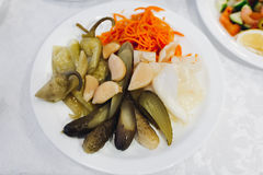 Pickled vegetables: cucumbers, cabbage, carrots on the plate. Royalty Free Stock Images