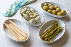 Pickled Vegetables Green and White Asparagus, Artichoke Heart and Unripe Green Almond Pickles in Plate. royalty free stock image