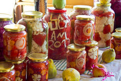 Pickled vegetables II. Jars with various pickled vegetables Stock Image