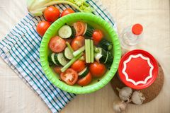 Pickled vegetables. With brine in green plate stock photos