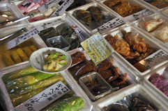 Pickled vegetables on sale. A closeup of different Japanese pickles on sale in a market stock photo