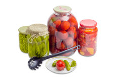 Pickled vegetables on saucer and in glass jars Royalty Free Stock Image