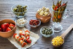Pickled vegetables on the wooden background Royalty Free Stock Image