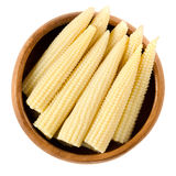 Pickled whole baby corn in wooden bowl over white Royalty Free Stock Photography