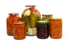 Pickles. From cucumbers and tomatoes in banks Royalty Free Stock Image