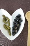 Pickles and black olives Royalty Free Stock Images