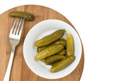 Pickles in the bowl and pickle on the fork.  Royalty Free Stock Image