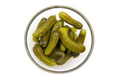 Pickles bowl on top. Pickles on bowl on white background seen from above Royalty Free Stock Images