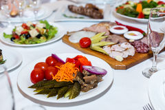 Pickles and cold cuts at the banquet table Royalty Free Stock Image