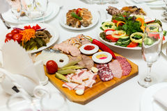 Pickles and cold cuts at the banquet table Stock Images