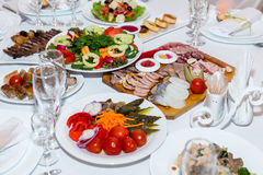 Pickles and cold cuts at the banquet table Royalty Free Stock Photo