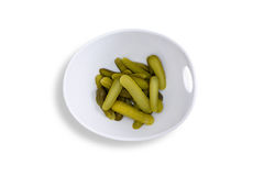 Pickles on Contemporary Bowl on White Background Royalty Free Stock Photos