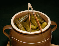 Pickles. Cucumber in a barrel of home salting. German farmers' products. Pickled cucumber in a clay pot royalty free stock photo