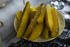 Pickles on a dish close up stock photo
