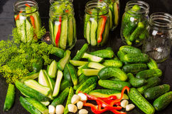 Pickles garlic and jars ready to pickle Stock Image