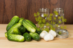 Pickles with jars and garlic Stock Photography